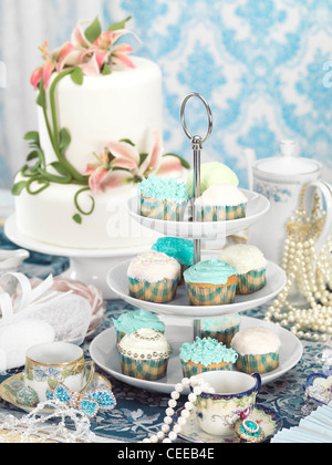 Still life photo of a luxurious tea party with sweets, jewellery and accessories - Stock Photo
