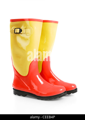 Cute colorful red yellow wellies rain rubber boots isolated on white background - Stock Photo