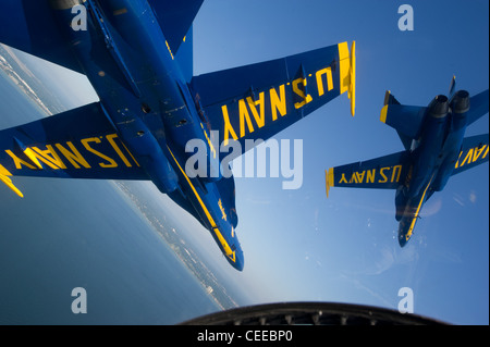 Pilots assigned to the U.S. Navy flight demonstration squadron, the Blue Angels, join their F/A-18 Hornet strike - Stock Photo