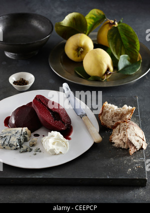 Poached quince in red wine spiced chilli hot - Stock Photo