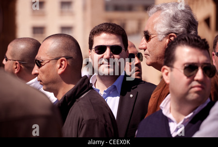 The young Lebanese politician Nadim Gemayel surrounded by bodyguards at a political rally in Beirut. His father - Stock Photo