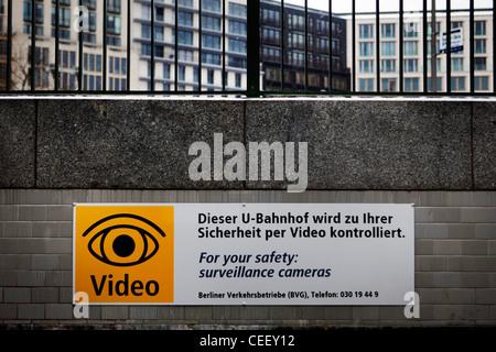 Entrance to Potsdamer Platz U-Bahn station with video camera warning - Stock Photo