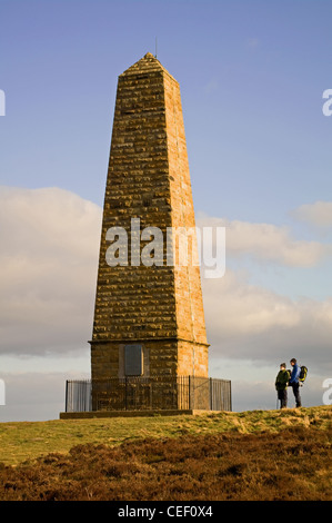 2 walkers standing by Captain Cook's Monument, Easby Moor, The Cleveland Way, North York Moors National Park, England - Stock Photo