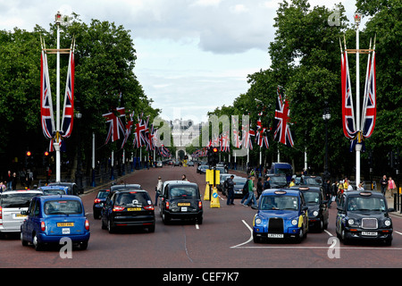 The Mall, London looking toward Admiralty Arch and decorated with the union Jack flags - Stock Photo