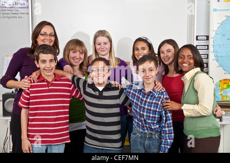 school class interracial Multi Ethnically diverse kids hang hanging out Group students teacher teachers aide smiling - Stock Photo