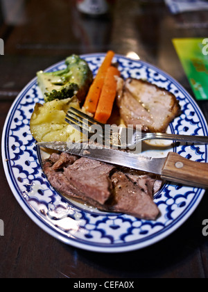 Roast lamb dinner. Traditional English Sunday dinner - Stock Photo