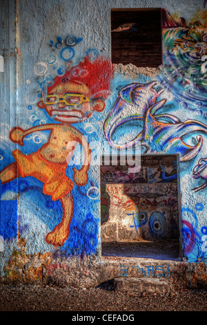 Graffiti in an old abandoned ruin - Stock Photo