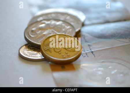 Australian currency, 50 dollar note and some coins - Stock Photo