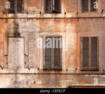 Wooden shutters on abandoned building - Stock Photo