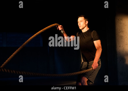 Athlete spinning jump ropes - Stock Photo