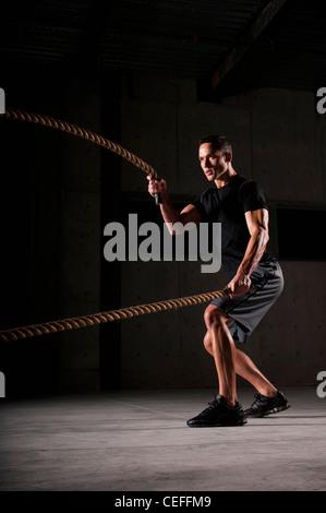 Athlete spinning jump ropes - Stock Photo