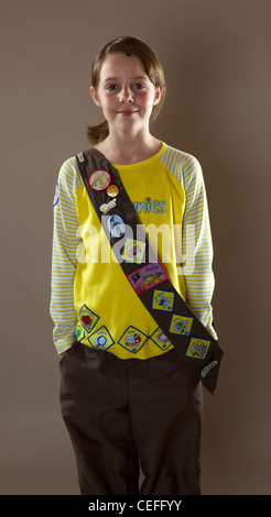 Portrait of a Brownie girl guide in studio - Stock Photo
