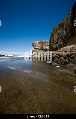 Time lapse view of waves on beach - Stock Photo