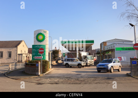 BP petrol filling station with cars on the forecourt. North Wales, UK, Britain - Stock Photo