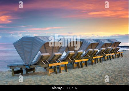 Beach chairs at the Four Seasons Resort. Hawaii, The Big Island. - Stock Photo