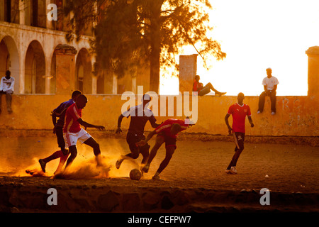 Football on the main square of Goree island, Senegal. - Stock Photo