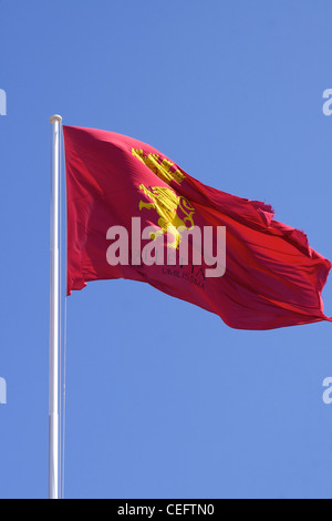 The red and yellow flag of Valletta flying over the city - Stock Photo