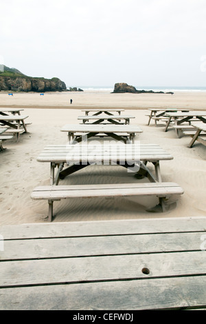 Perranporth, Cornwall, England the tables at The Watering Hole Bar, Pub on the beach looking out  to sea coast - Stock Photo