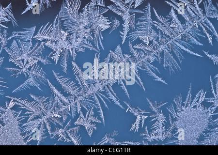 Photo of frosty drawing on a windowpane - Stock Photo