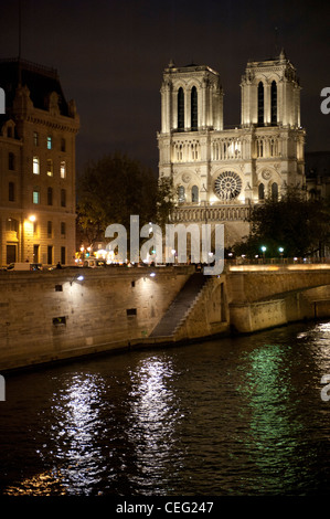 The cathedral Notre Dame de Paris on Île de la Cité, the cradle of Paris in the Seine, illuminated at night - Stock Photo