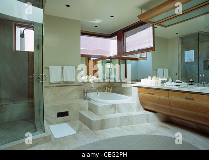 Steps up to bath in marble spanish bathroom with a glass corner stock photo royalty free image Step up master bedroom