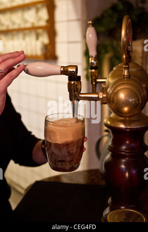 pulling pint of ale - Stock Photo