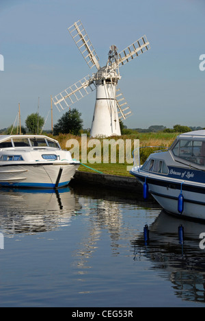 Thurne Mill and Thurne Dyke, with two moored cruisers, Norfolk Broads, England - Stock Photo
