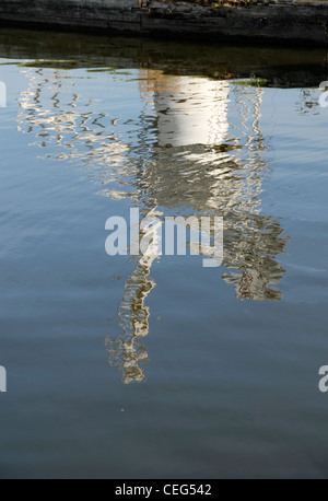 Reflection of Thurne Mill, Norfolk Broads, in Thurne Dyke - Stock Photo