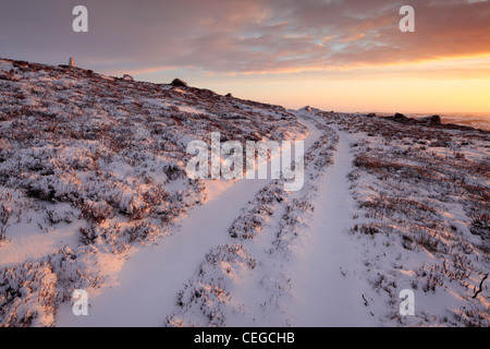 A crisp winter sunrise over Nidderdale as seen from High Crag Ridge near Pateley Bridge and Glasshouses in Yorkshire, - Stock Photo