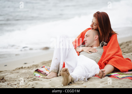 Young happy couple on the beach. - Stock Photo