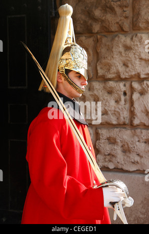 Ceremonial sentry of the Queen's Life Guard at Horse Guards Arch, London, UK - Stock Photo