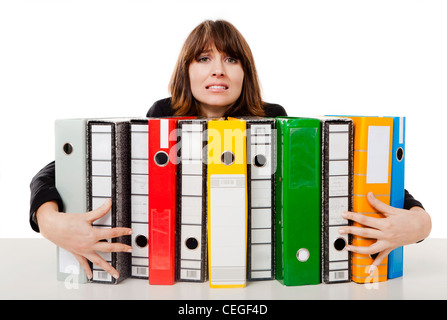 Business woman in the office embracing multiple folders, isolated on white background - Stock Photo