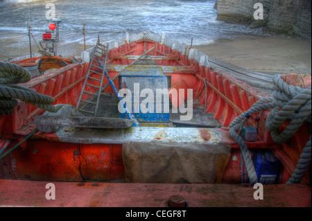 Wooden fishing boats at North Landing Bay, Flamborough in North Yorkshire - Stock Photo
