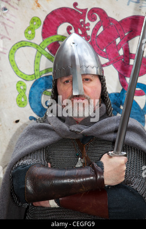 Viking swordsman re-enactor wearing Helmet, with nasal protector, and carrying sword at the 27th Annual JORVIK Festival - Stock Photo