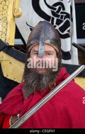 Bearded armed Viking re-enactor wearing Helmet and carrying sword weapon at the 27th Annual JORVIK Festival in York, - Stock Photo