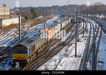 Direct Rail Services (DRS) freight train running through Ipswich on route to the port of Felixstowe, Suffolk, UK. - Stock Photo