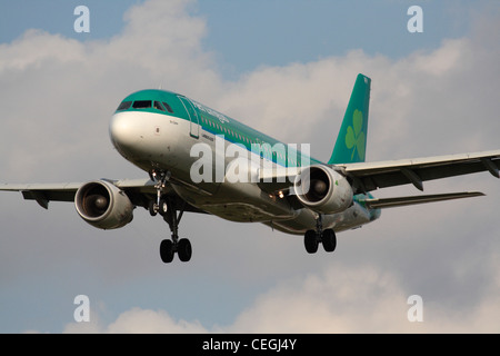 Aer Lingus Airbus A320 airliner flying on approach. Closeup front view. - Stock Photo