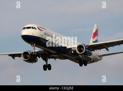 British Airways Airbus A321 passenger jet plane on approach. Close-up front view. - Stock Photo