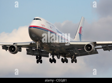 Malaysia Airlines Boeing 747-400 jumbo jet on arrival. Close up front view. - Stock Photo