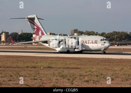 Qatar Emiri Air Force Boeing C-17 Globemaster III taxiing for departure from Malta - Stock Photo