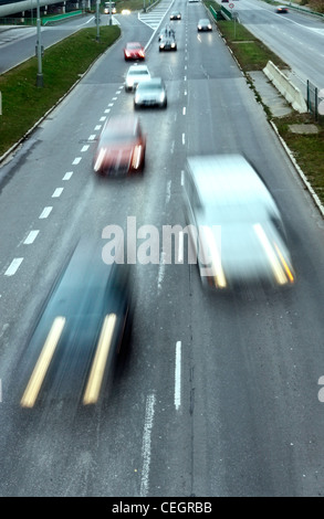 Highway with lots of cars. High contrast and motion blur to rise speed. - Stock Photo