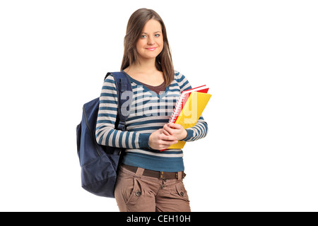 Smiling school girl posing with her books isolated on white background - Stock Photo