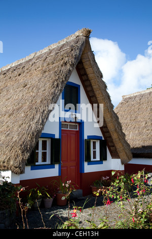 Palheiro houses_ Old Traditional A-framed houses of Santana, Madeira. - Stock Photo