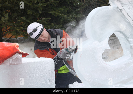 Ice sculpture using a power hand sander - Stock Photo