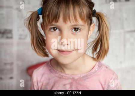 Closeup portrait of young girl smiling for the camera - Stock Photo