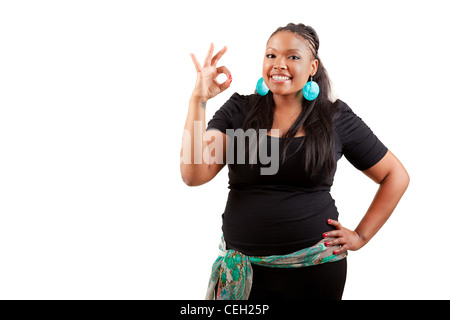 Portrait of a young african american woman making ok gesture - Stock Photo