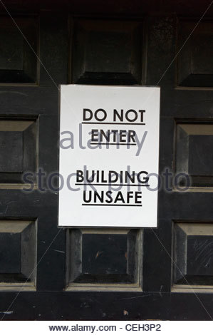 Building Unsafe sign on a door Do Not Enter - Stock Photo