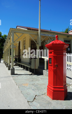 A red letterbox outside the post office in Arrowtown, New Zealand - Stock Photo