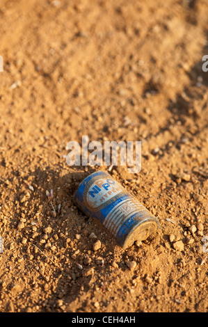 Discarded battery in the earth in the Indian countryside