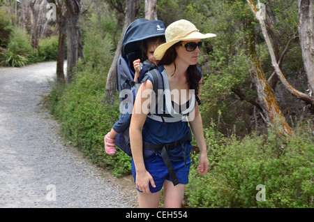 A Mother and here baby are hiking in the nature. - Stock Photo